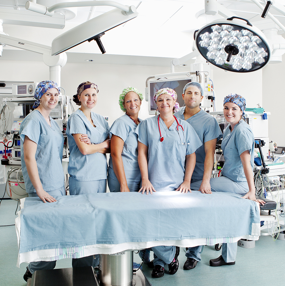 Positive & happy group photograph of operating room staff on location at London Health Sciences Centre, University Hospital, London Ontario