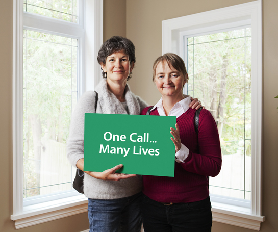 Environmental Portrait, Lovely Natural Light of Two Woman holding organ donation Card.