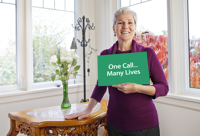 Environmental Portraits of a 60+ Woman Holding Organ Donation Card.