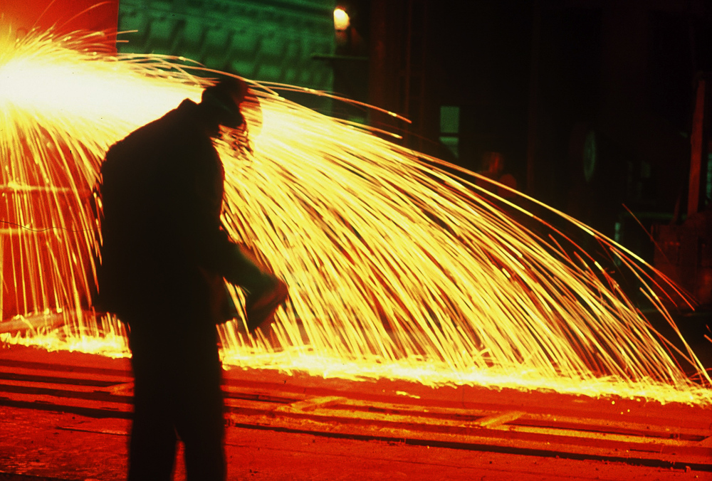 Intense Colored Abstract of Steel Worker Pouring Molten Steel