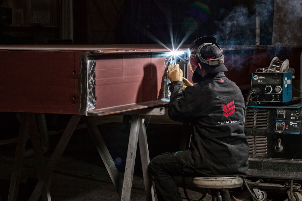 Professional photo for publication of Steel worker welding