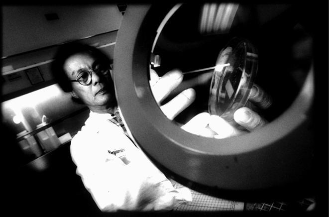 Dramatic Extreme WideAngle Black & White Portrait  of Lab Technician