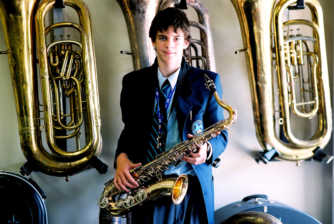 Environmental Portrait, Student holding Saxophone in school uniform, Appleby College, Oakville, Ontario