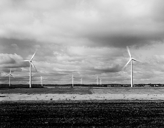 Black & White Farm of Power Generating Windmills & Farm Landscape