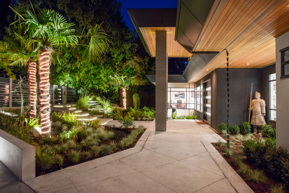 Here we see the outside entrance of this Award Winning West Vancouver custom home photographer shot at night time