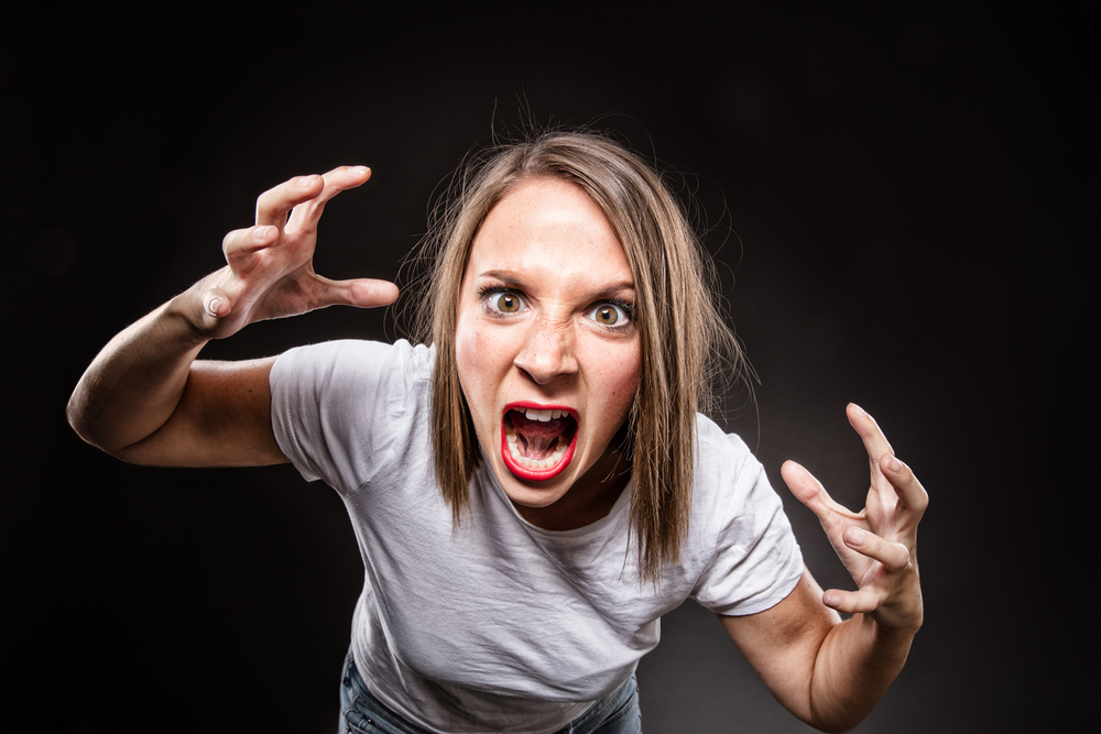 Genevieve showing anger emotion in advertising concept photography as a Vancouver studio portrait