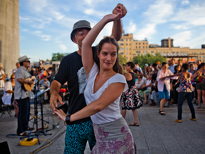 Visitors dance at Arriba. Photo by Liz Ligon