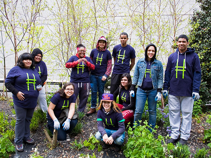 The teens in our first Green Corps program smile for the camera. Since 2011, we've expanded Green Corps to a six-month initiative and have added two more teen programs. Photo by Joan Garvin