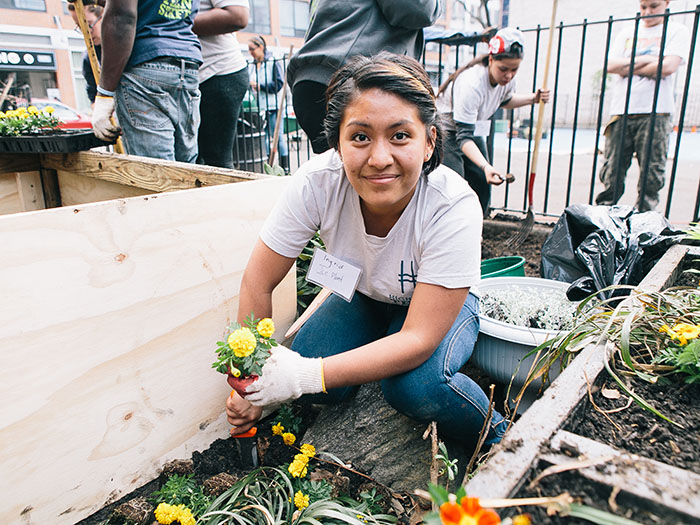 High Line volunteers and staff, like Green Corps teen Ingrid Milner, helped restore a local community garden this spring in our first Neighbor Day. Photo by Rowa Lee