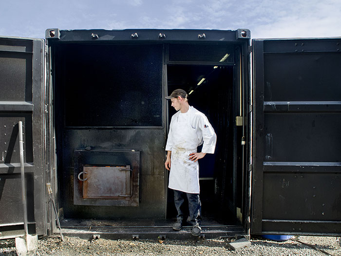 Pitmaster Joe minds Delaney BBQ's outdoor water-tank-turned-smoker.