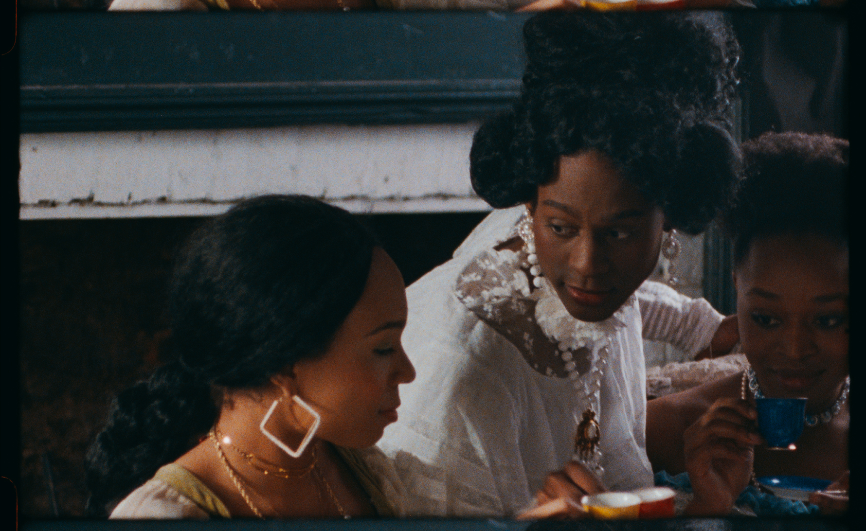 A still from Tourmaline's Salacia that depicts three Black women in early 19th century dress
