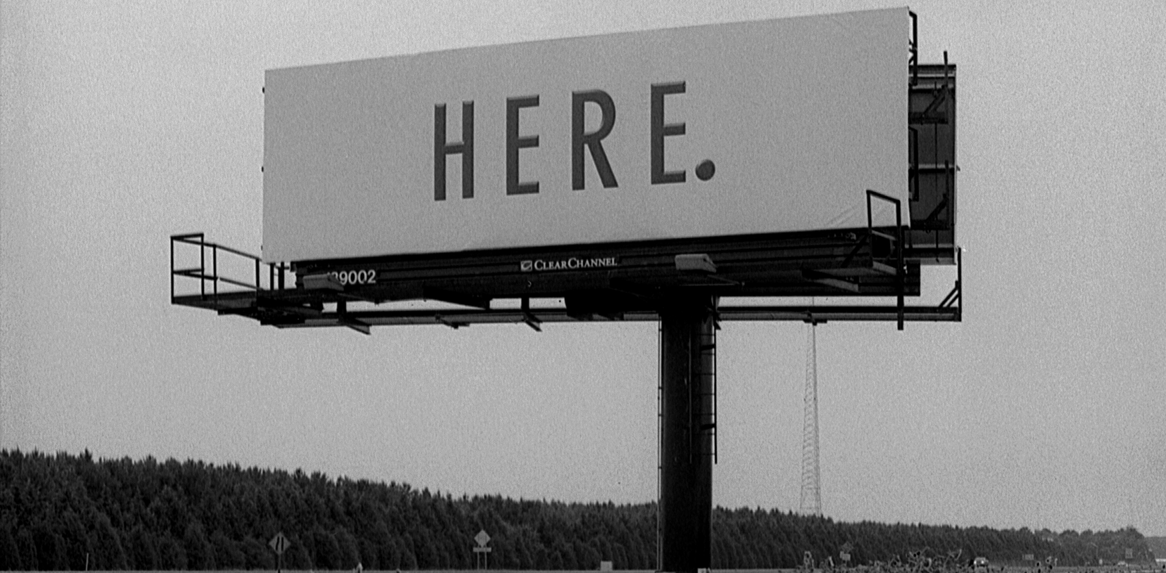 "A billboard that reads ""Here."""