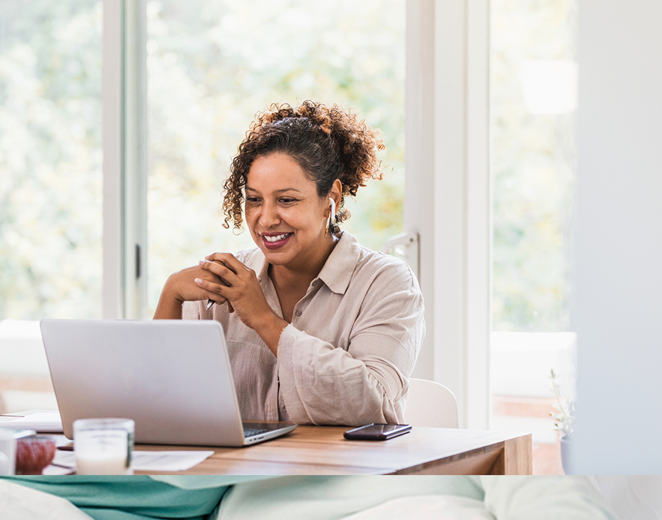 Stock image of adult woman sitting at a laptop