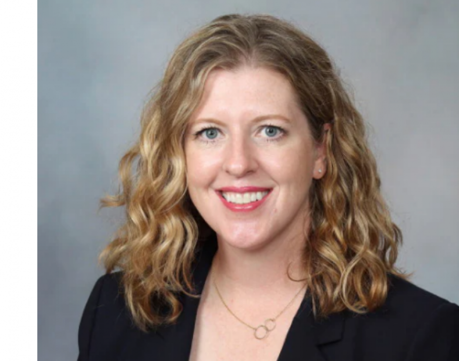 Headshot of Dr. Wendy Allen-Rhoades. She is smiling, facing forward. She is wearing a black blazer over a white shirt, with a smal golden necklace. Her hair is light brown and shoulder-length.