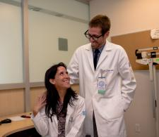 Dr. Enrique Soto and r. Yanin Chavarri exchanging a smile