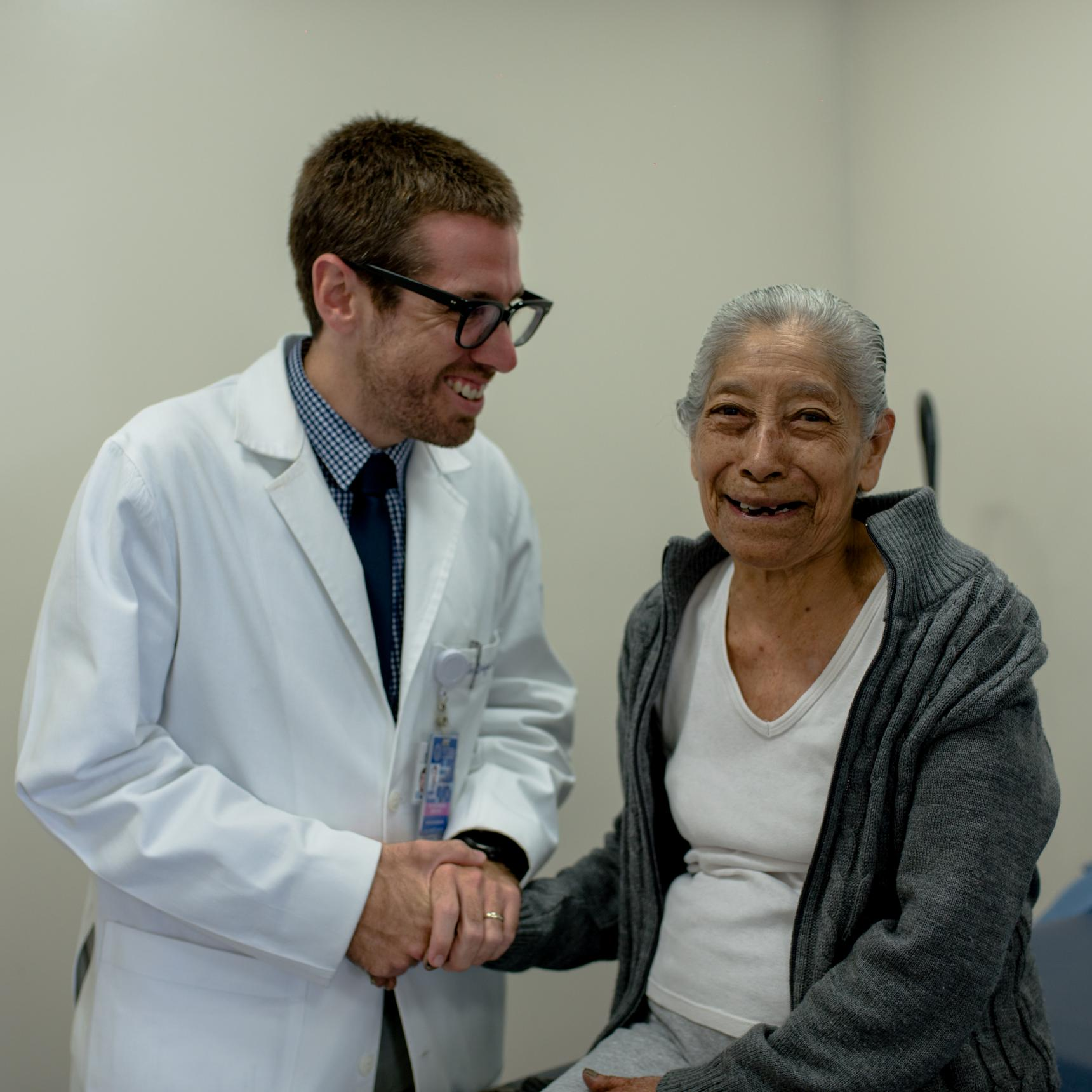 Dr. Enrique Soto smiling and laughing with a patient