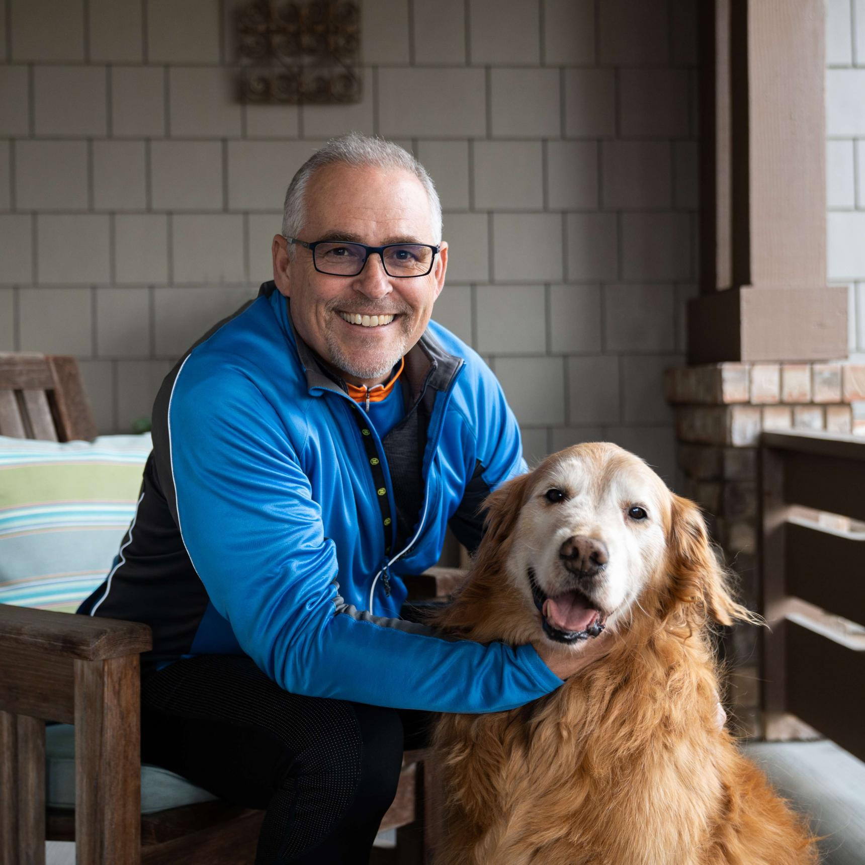 Cancer survivor and Conquer Cancer fundraiser Mark Crafts pictured with his dog