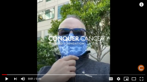 Mark Crafts wearing a bandana outside of the hospital where he receives treatment for cancer. Screenshot linking to his YouTube video.