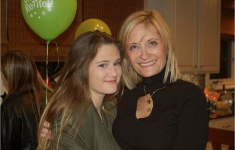 Brenda and her daughter, Bella, pictured together at an event. Brenda, on the left, has blonde hair and is wearing a black dress. Bella has dark brown hair and is wearing a dark gray shirt.