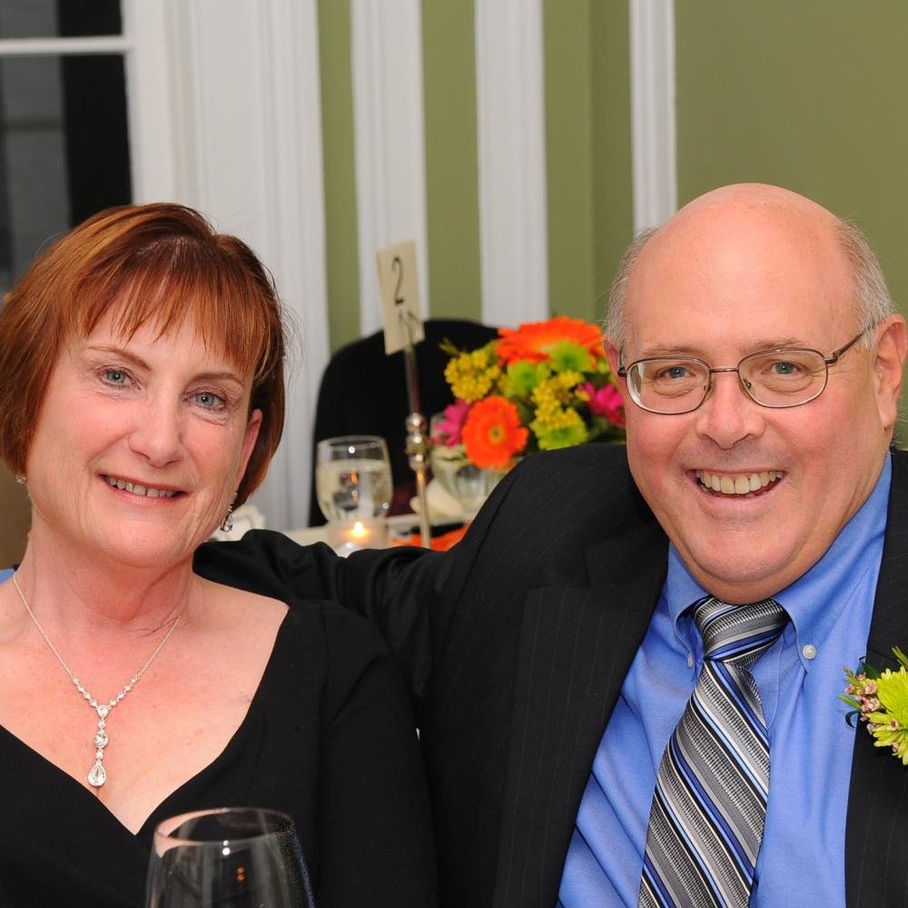 Jane and Bill Coulbourne together at a wedding