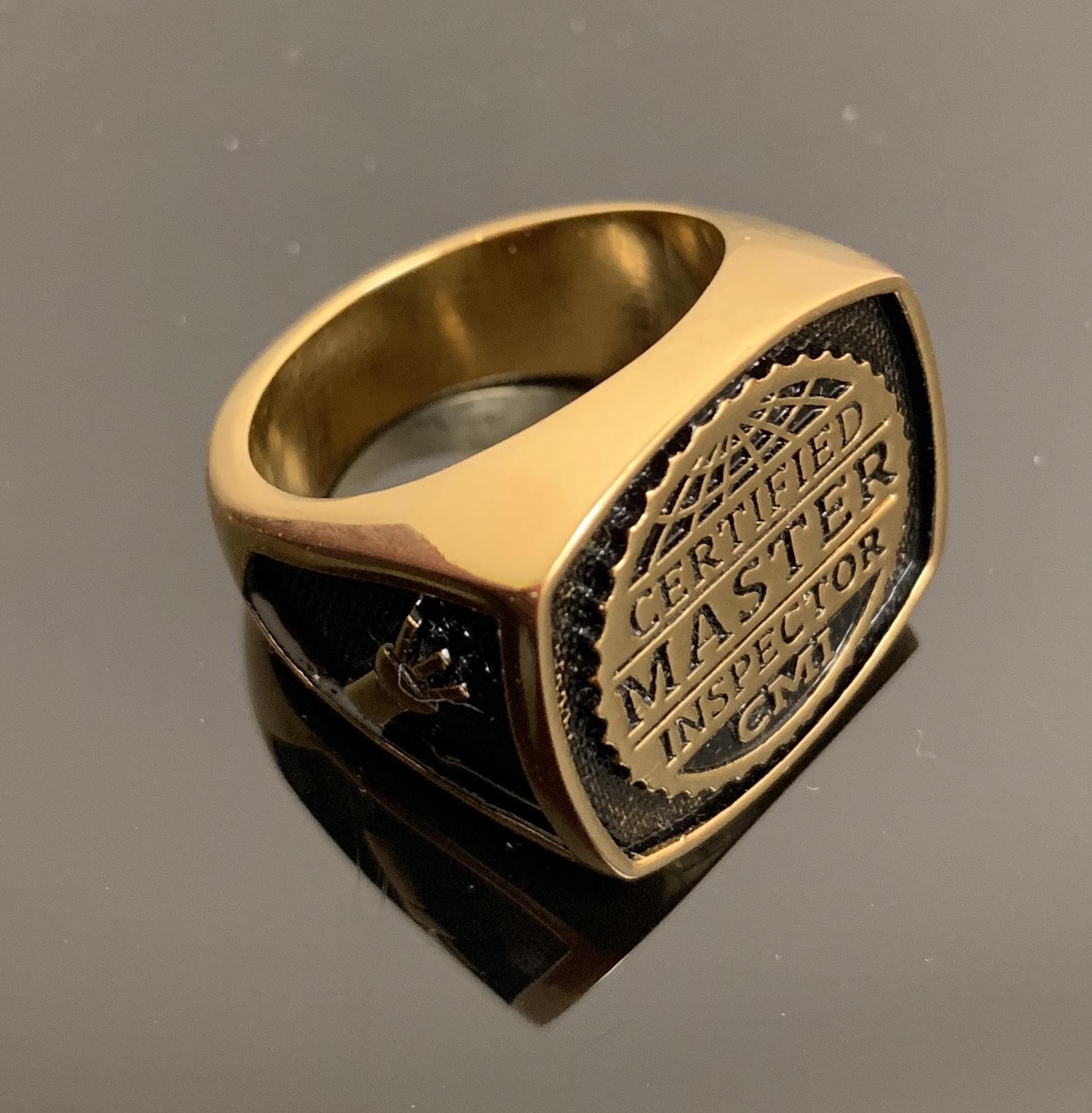 Certified Master Inspector gold ring.