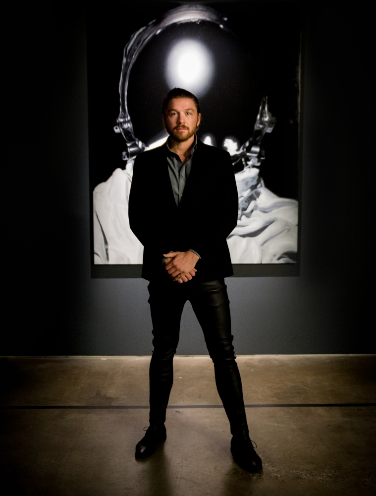 Art curator and gallerist Philippe Hoerle-Guggenheim in front of Marc Gumpinger piece