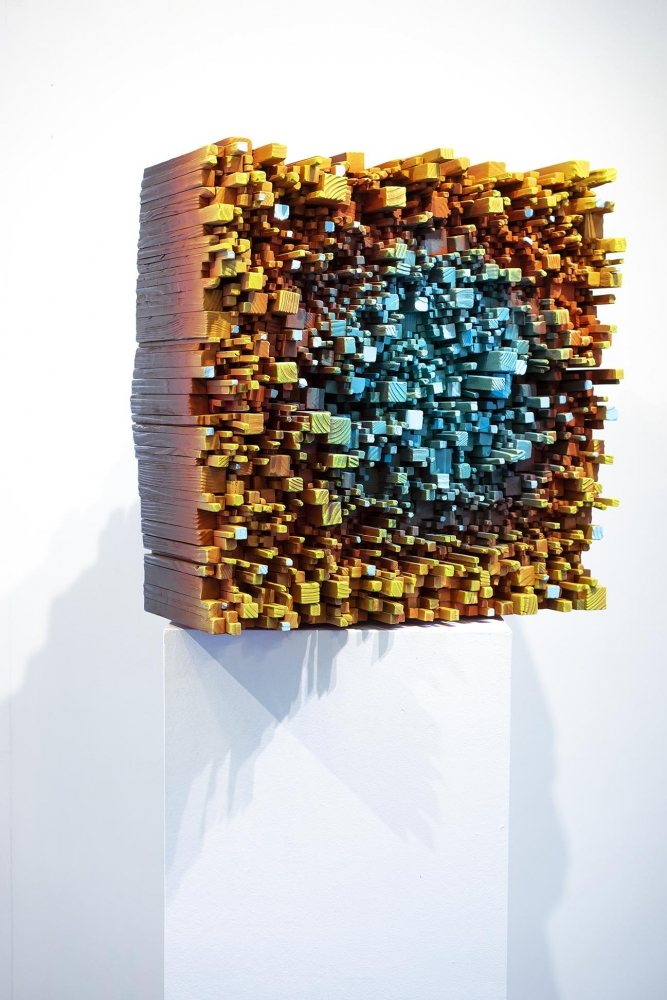 Colorful Pixelated Wood Sculptures Reveal Complexities of the Human Spirit
