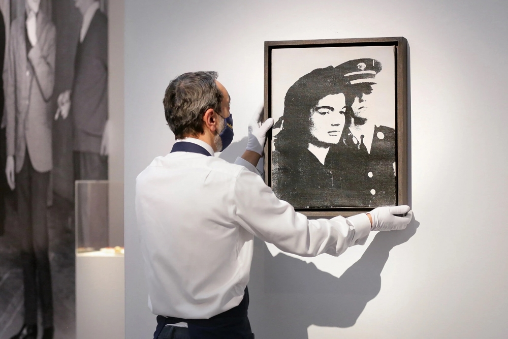 "A 1964 Andy Warhol, ""Jackie,"" went for about $1.1 million"