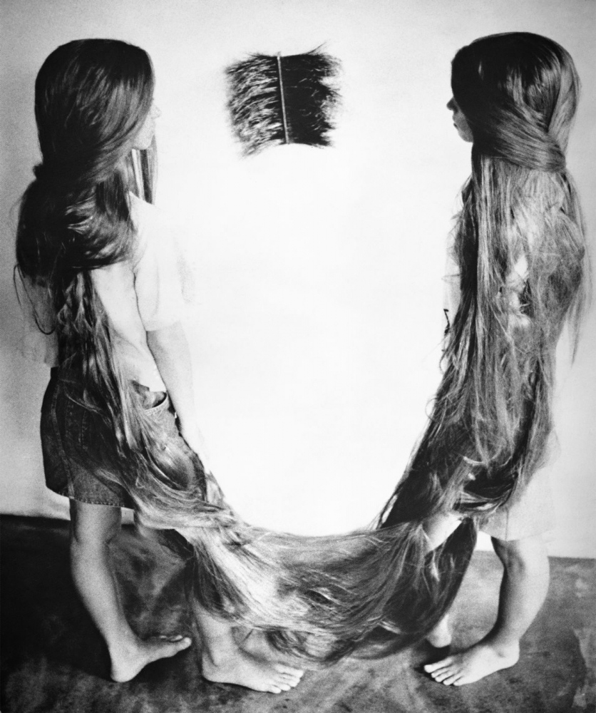 two girls with long hair