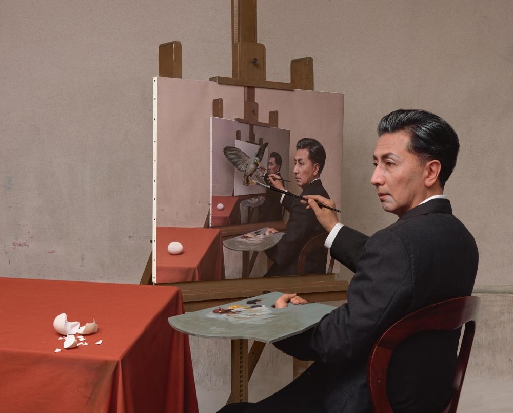 Morimura sitting at easel