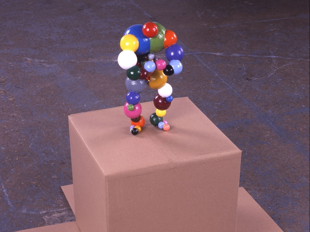 ball sculpture on cardboard box