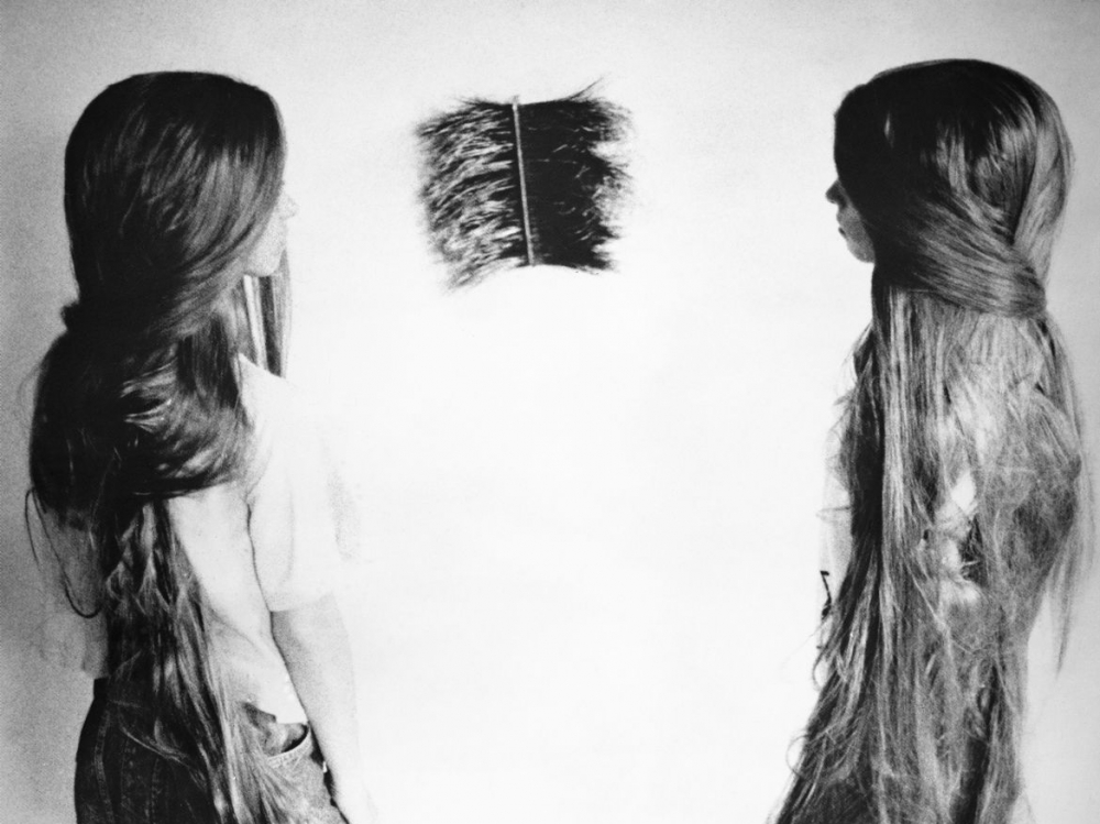 2 girls with long hair