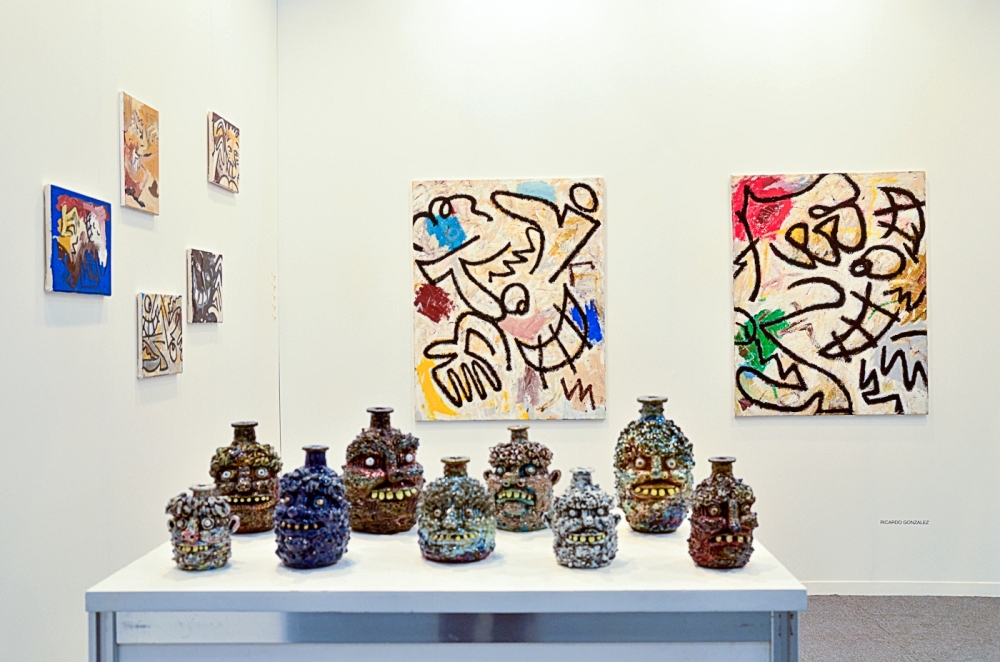 Rebecca Morgan jugs and Ricardo Gonzalez paintings in art fair