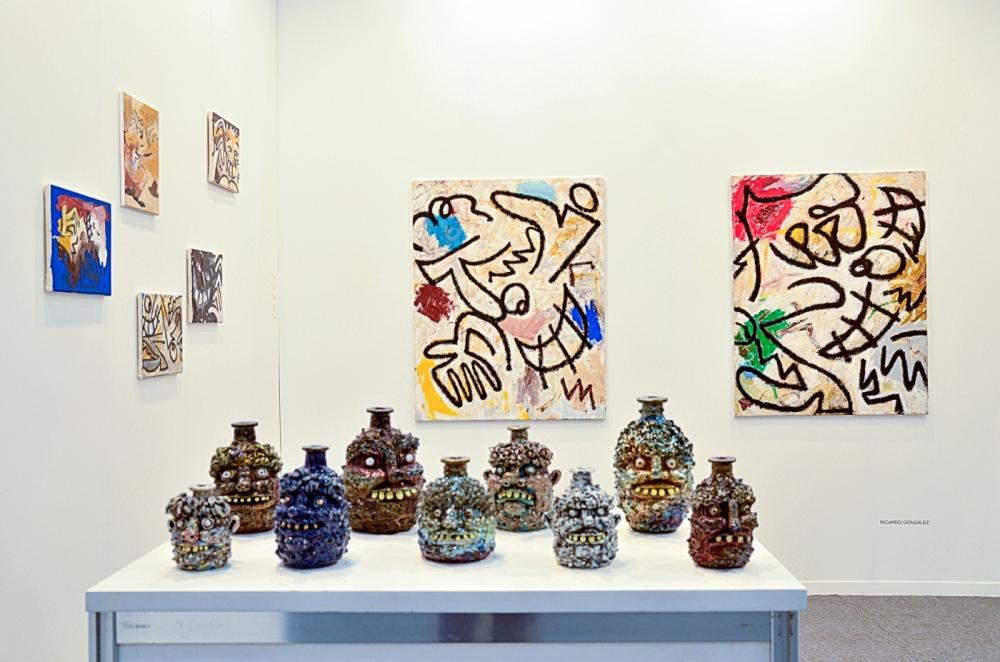Rebecca Morgan jugs and Ricardo Gonzalez paintings in art fair
