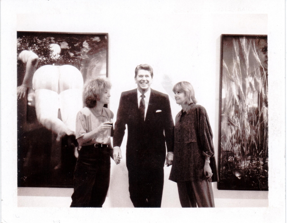 Helene Winer and Janelle Reiring in front of Cindy Sherman works