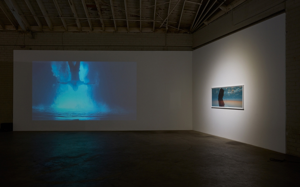 """Illusion,"" installation view, 2016. Pictured: Cheng Ran, ""Angels of the Millennium #6,"" 2012 (video); ""Always I Trust, Film Still No. 2,"" 2014."