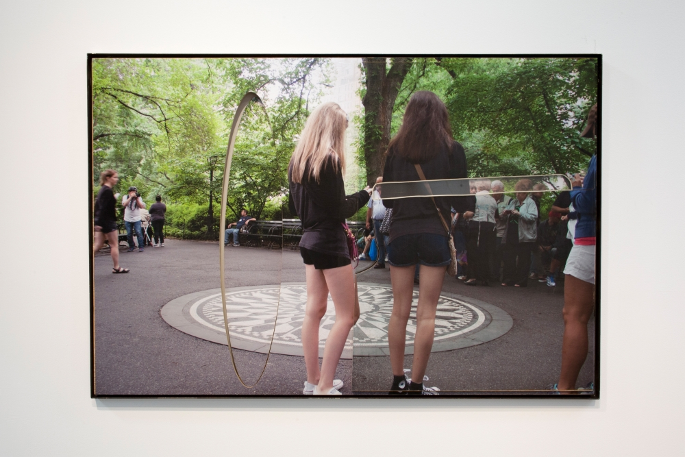 """Central Park (Imagine with girls)"", 2015. Inkjet on adhesive vinyl, plywood, plexiglass, rubber, iron frame. 72 x 48 inches."