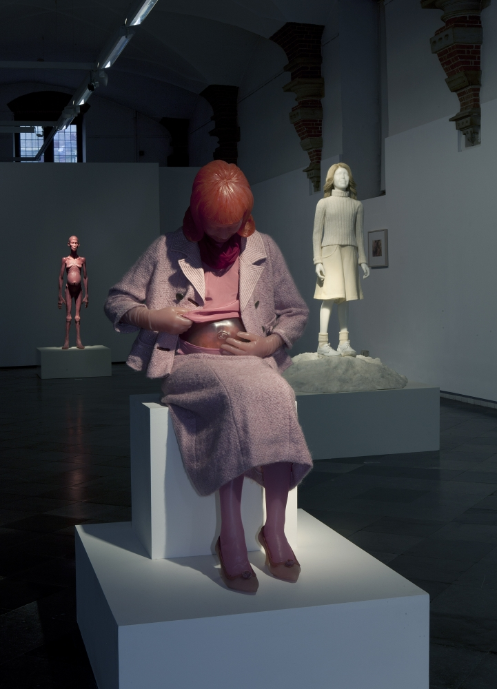 Installation view from Edmier's exhibition at Frans Hal Museum in 2013. Fesatures Pink beverly edmier sculpture in foreground, white sculpture of woman in the middle ground and pink alien sculpture in the background.