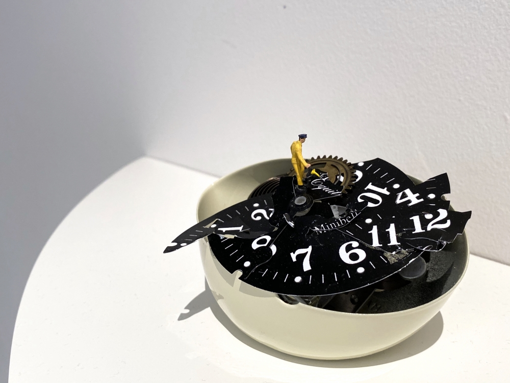 Liliana Porter, To Fix It [Man in Yellow], 2020. Broken table clock and figurine, 3 x 4 1/2 x 3 in.