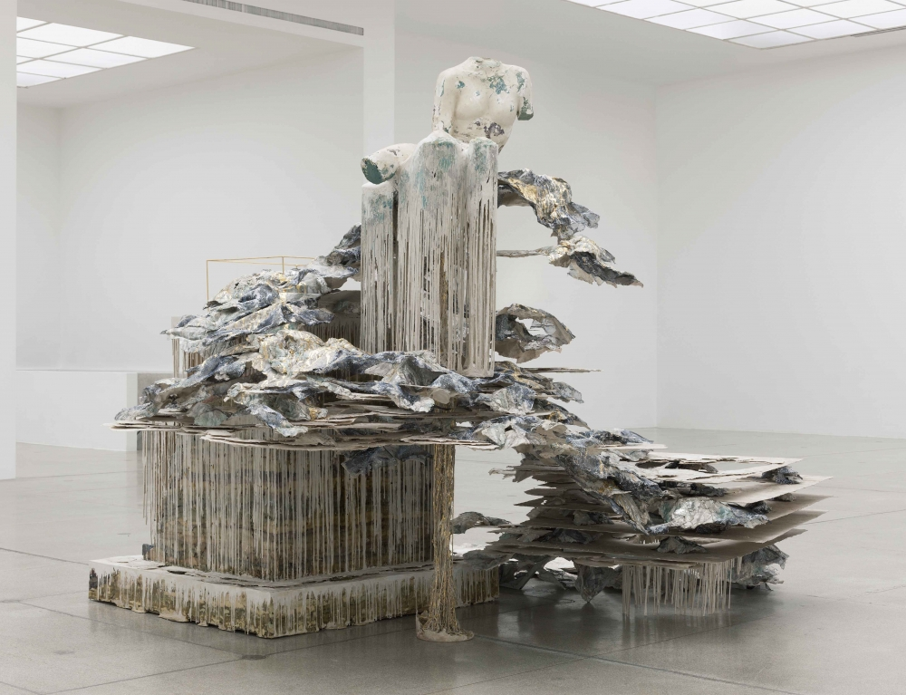 an image of an artwork by Diana Al-Hadid printed alongside an interview with the artist
