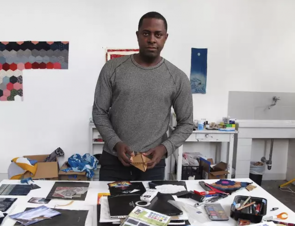 Sanford Biggers at work on his art in his studio