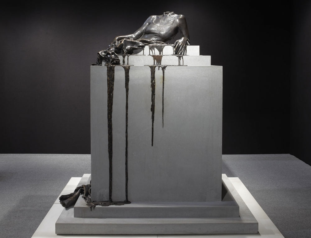 a bronze sculpture by Diana Al-Hadid in an exhibition reviewed by an art critic