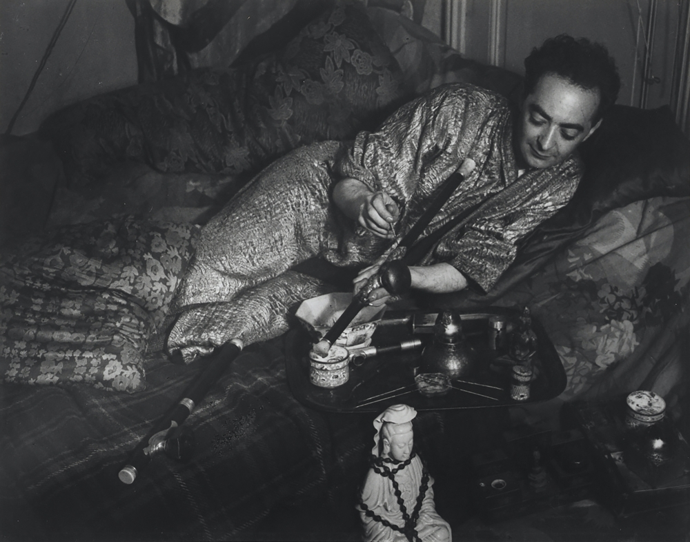 Black and white photographic portrait of Brassaï wearing a kimono