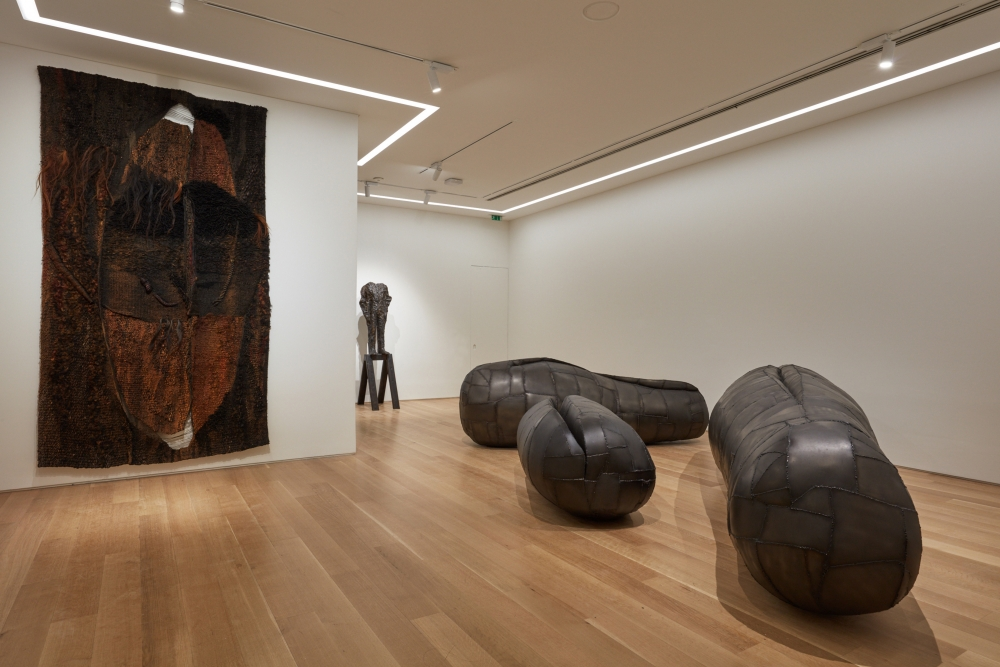 Installation view of sculptures and a textile work by Magdalena Abakanowicz