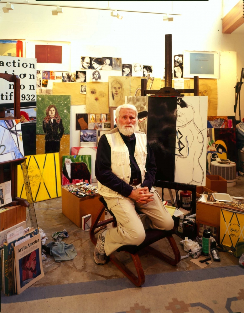 Color photographic portrait of R.B. Kitaj in his Studio surrounded by paintings