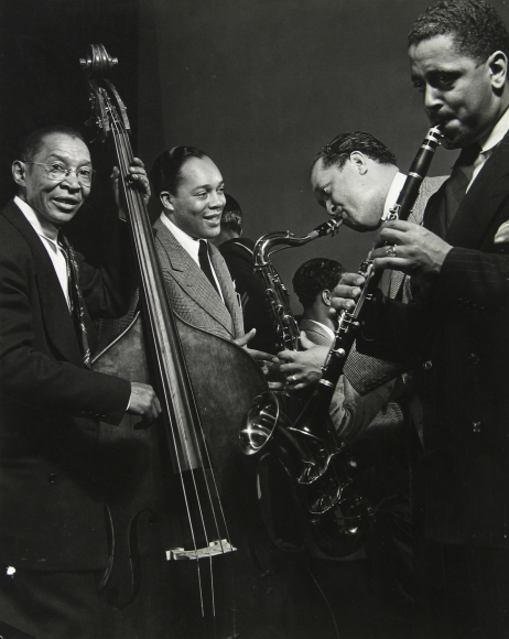 Gjon Mili - Lester Young on saxophone with other jazz musicians during jam session at Gjon Mili's studio, NY, 1943 - Howard Greenberg Gallery