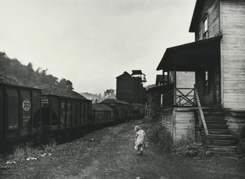 Marion Post-Wolcott, Unemployed coal miner's daughter carrying home can of kerosene, company housing, Scotts Run, W. Va., 1938