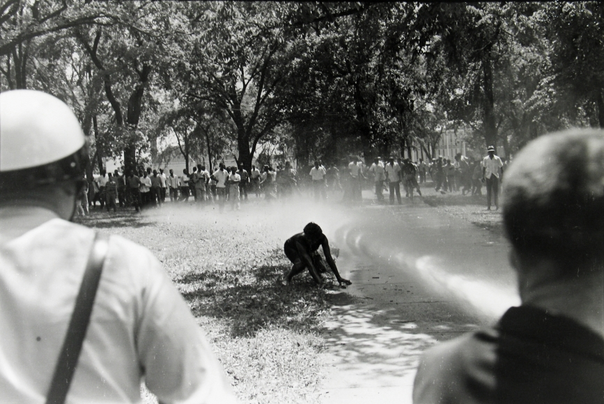 Bob Adelman - Demonstrator knocked down by fire hose, Kelly Ingram Park, Birmingham, Alabama - Howard Greenberg Gallery