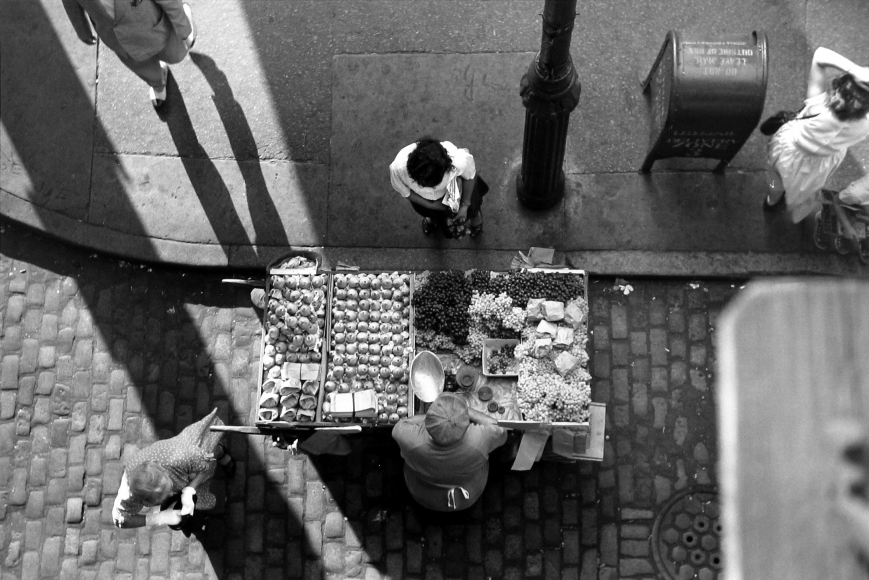 Ruth Orkin - Fruit Stand under Third Avenue El, c.1949 - Howard Greenberg Gallery