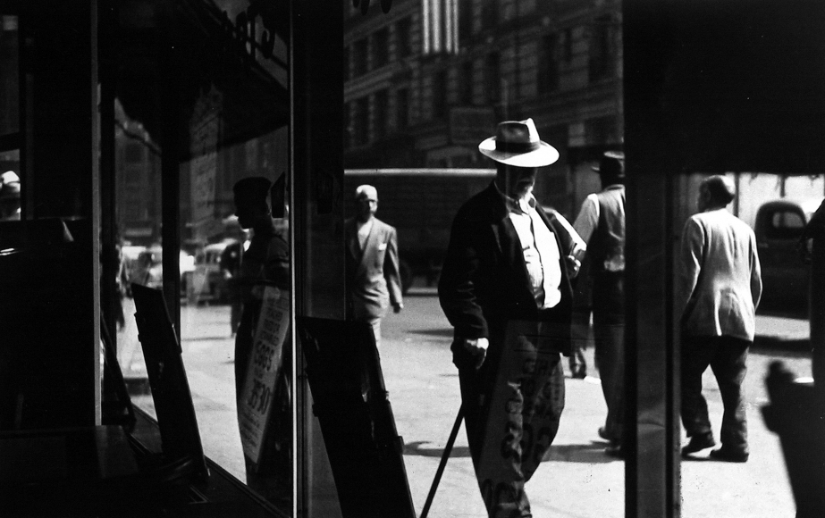 Sy Kattelson - Man with Cane, 1950 - Howard Greenberg Gallery